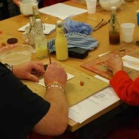 Carers using vegetable inks/dyes for their recipe card illustrations.