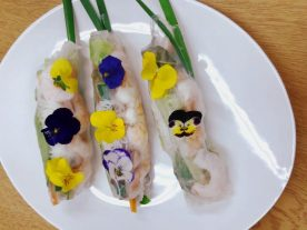 finished summer rolls with viola flowers